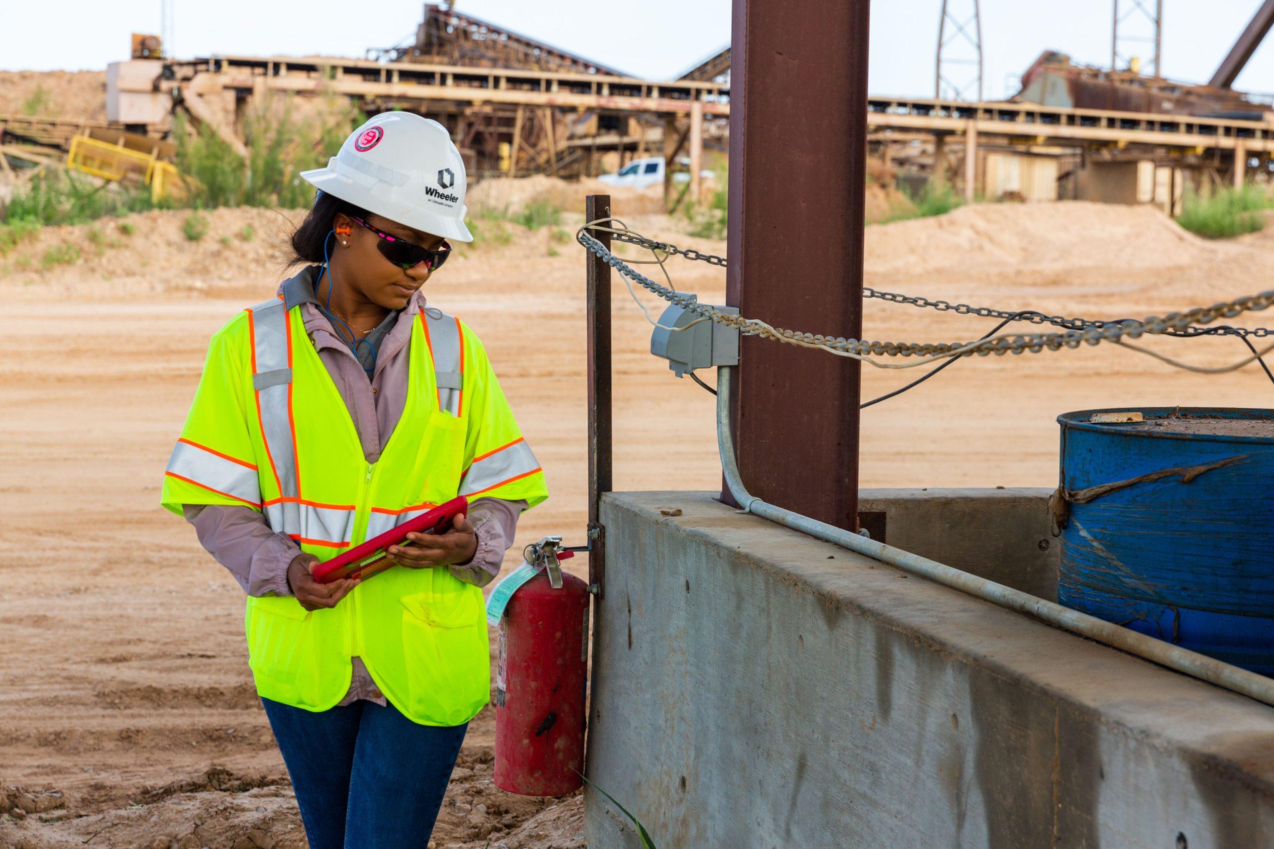 Wheeler Woman on Jobsite with Ipad